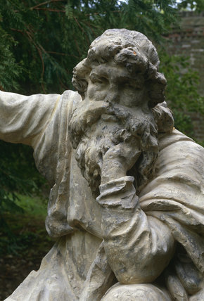Close-up (above the waist) of the stone statue 'The Druid' under woods in the grounds of Erddig