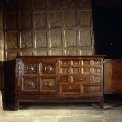 A wooden cupboard in the Hall at Little Moreton Hall