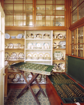China Closet in the Housekeeper's passage at Tatton Park including part of a 900-piece 19th century French glass service.