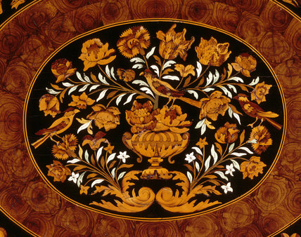 Detail of table veneered with marquetry in various woods depicting birds in a floral scene, in the Oak Drawing Room at Powis Castle