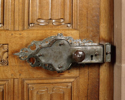 Close-up of the ornate lock and door handle in the Oak Drawing Room at Powis Castle