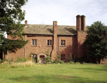 View of the south front of Tatton Old Hall, situated in the park land near Tatton Mere