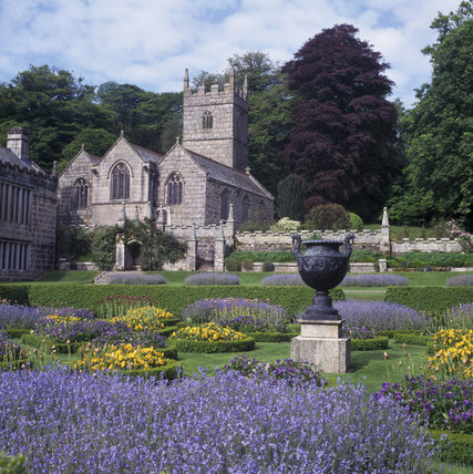 View across the garden at Lanhydrock in spring, looking south west to the church