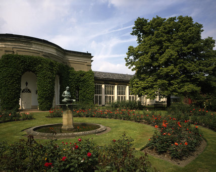 The Orangery seen across the Rose Garden, with a small pond and fountain (not working)