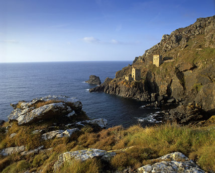A distant view of the ruined engine houses of Botallack Mine on the St Just coast