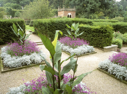 The Verbena Parterre, with the top of The Shelter House in the background, at Biddulph Grange Garden, Staffs