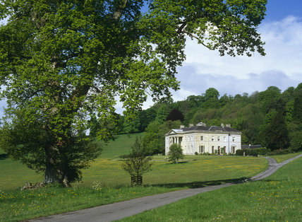 View across the path and parkland of Philipps House, Salisbury, Wiltshire, an early 19th century neo-Grecian house designed by Jeffry Wyatville for William Wyndham, completed in 1820