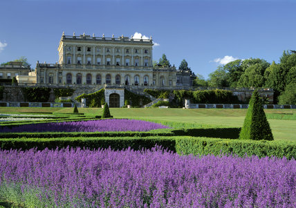 Bright purple Catmint makes a brilliant foreground to this view of the garden front of Cliveden