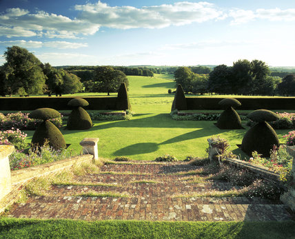 View down the steps and across the lawns to the south of the house at Hinton Ampner, Hampshire