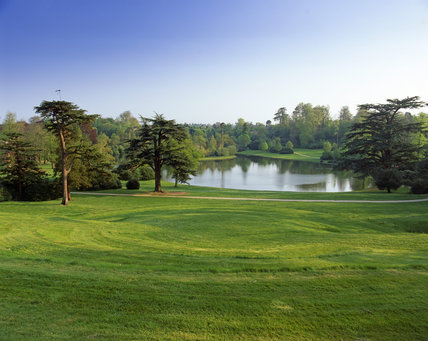 A panoramic view over the lake in Claremont Garden, the surrounding trees in fresh green spring foliage