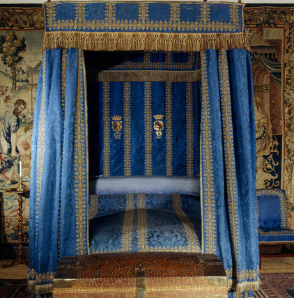 An end on view of the bed in the Blue Room