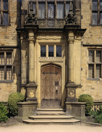 The main entrance door at Gawthorpe Hall in Lancashire, built in 1600-05, and restored by Sir Charles Barry in the 1850's