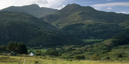 Snowdonia in summer - a view of the mountains with the Hafod Y Llan estate in the middle distance