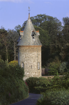 The Water Tower in the gardens of Trelissick brightly lit by the sunlight