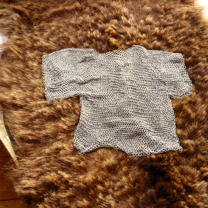 Replicas of finds from the Sutton Hoo Saxon burial site - chain mail shirt on a bear skin