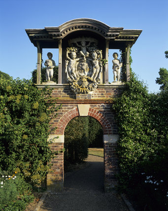 A decorative archway which serves as a focal point in Nymans