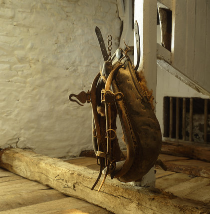 An old leather horse collar hanging in the stables at Llanerchaeron, an C18th estate near Aberaeron