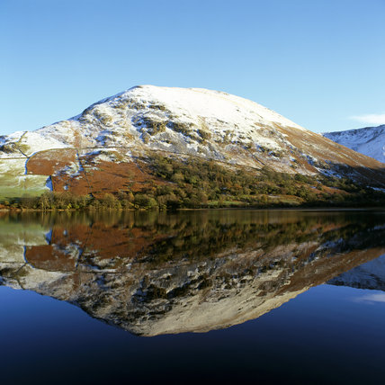 View across Brothers Water of the snow covered Hartsop Dodd
