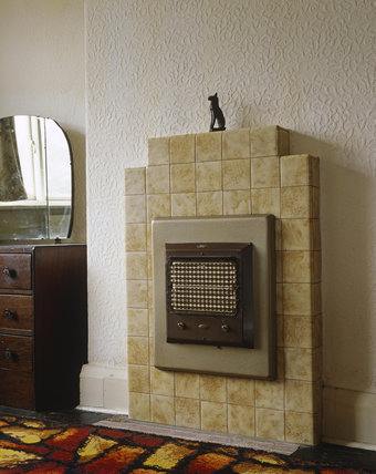 1930's electric fire fitted into a tiled fireplace in a rear bedroom at John Lennon's home, 'Mendips', Liverpool