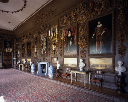 The Carved Room at Petworth with the four paintings by Turner restored to the panelling, looking North