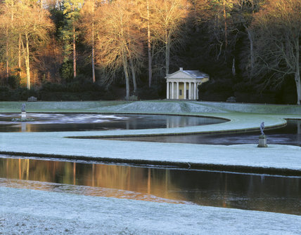 The Water Garden at Fountains Abbey towards the Temple of Piety with the statue of Bacchus by one of the crescent ponds