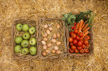 Three baskets of apples, eggs, tomatoes & carrots at the farm shop at Osterley Park