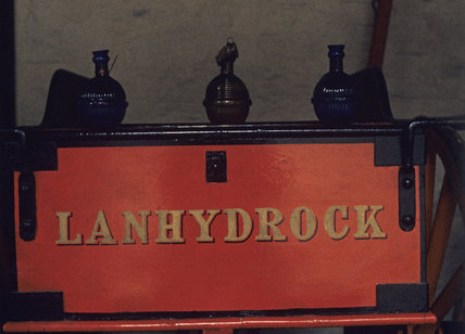 Detail of the Lanhydrock Fire Engine, showing the name of the house painted in gold on the red panel