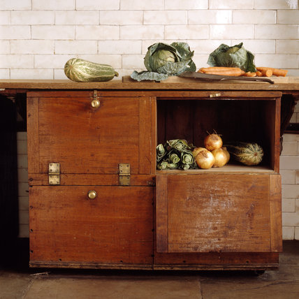 The vegetable cupboard in the Scullery at Tatton Park with fresh vegetables.