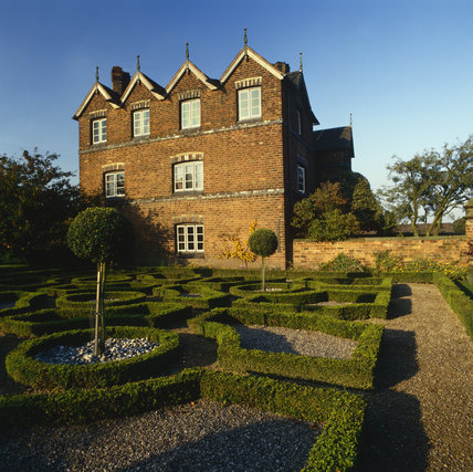 The south front of Moseley Old Hall seen from the knot garden with dwarf box and gravel paths