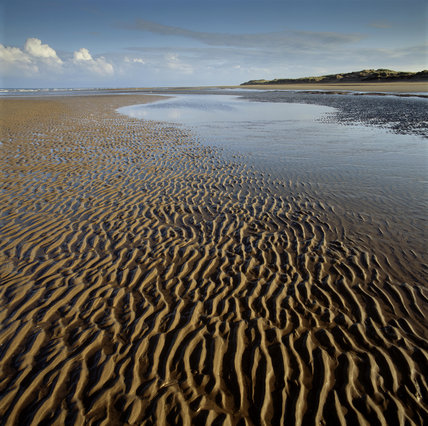 The Deserted Beach At Formby Merseyside With Wave