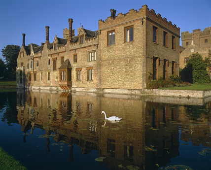 The moat at Oxburgh Hall with a swan in the foreground