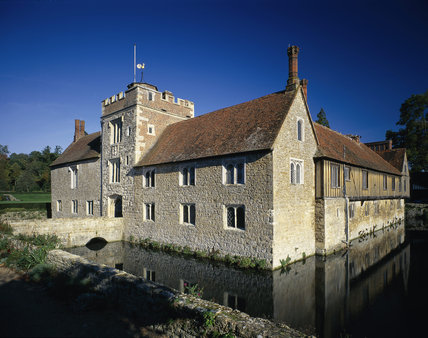A view of the south west and south east elevations of Ightham Mote looking from the south