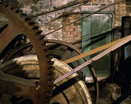A view of the water-powered wheels and pulleys, that power the mill that practices the art of spade making