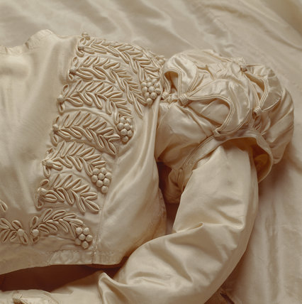 Detail of the white silk wedding dress worn by Mary Elizabeth Williams when she married George Hammond Lucy on 2 December 1823