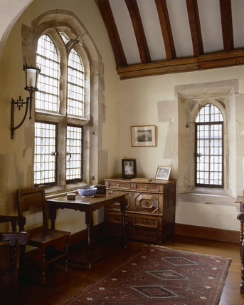 The South Oriel Annex with arched ceiling and window and wooden beamed roof, at Great Chalfield Manor, near Melksham, Wiltshire