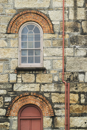 Brick arch details over the windows at the Cornish Mines & Engines at Pool, near Redruth, Cornwall