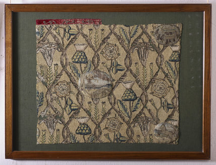 Cushion cover with medallions illustrating fables in a trellis enclosing rose, thistle and lily motifs, and a fox devouring nestlings that have fallen out of their nest, at Hardwick Hall, Derbyshire