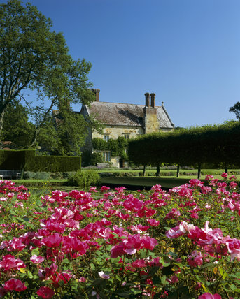 A view over the Rose Garden towards the Jacobean house at Bateman's, East Sussex, home of Rudyard Kipling from 1902 until 1936