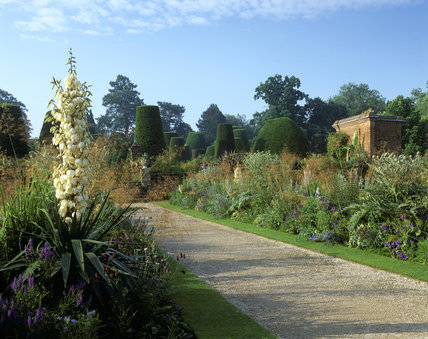 The double border on the raised terrace in the garden at Packwood House, Warwickshire