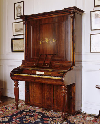 An upright Broadwood piano c.1840 in the Governess's Dayroom at Hanbury Hall, Worcestershire.