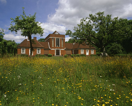 Looking beyond the buttercups to Sandham Memorial Chapel