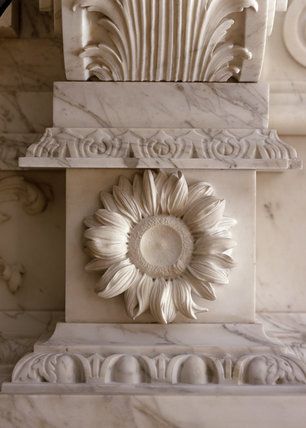 Sunflower detail on the marble fireplace, in the Marble Hall, Clandon