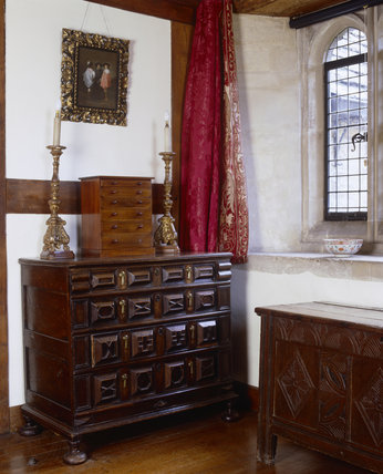 Carved wooden chest with carved geometric patterns in the North Bedroom at Great Chalfield Manor, near Melksham, Wiltshire