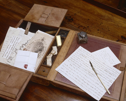 Letter and writing equipment on Carlyle's desk at Carlyle's House, 24 Cheyne Row, London, the home of writer Thomas Carlyle and his wife from 1834 to 1881