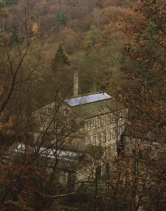 Gibson Mill, an eighteenth-century former cotton mill, showing the solar panels on the roof at Hardcastle Crags, West Yorkshire