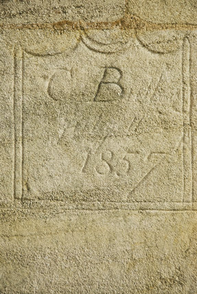 Nineteenth century initials and graffiti etched into the stonework of Lyveden New Bield, Peterborough, Northamptonshire