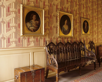 The Gothick Corridor at Hanbury Hall, Worcestershire with Gothick-patterned wallpaper of the 1830s and the late Georgian oak settee in the Gothick taste