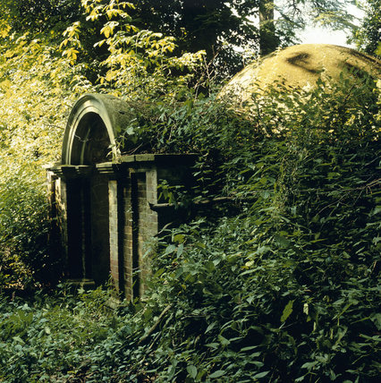 Ice House in the grounds at Hatchlands covered in foilage