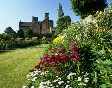 Herbaceous border in high summer with the house in the distance at Chartwell, the home of Sir Winston Churchill in Kent