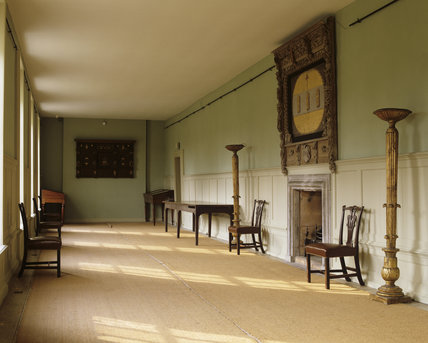 The Long Gallery at Hanbury Hall, Worcestershire, looking towards the fireplace and Jacobean overmantels